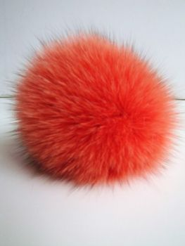 Bobble, pompom made of real fox fur in orange.