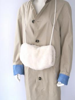 Lambskin muff with pocket and hand warmer natural