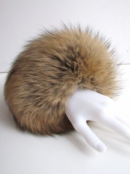 Fur cuff made of real raccoon in nature